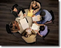 Top view of group of people meeting on a table.
